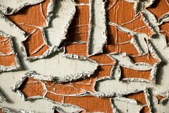 Old and peeled creaky paint. In course of time the paint of white tone peeled off the old planks and crackled, wood texture, background, colorful, cracks in Stock Image