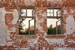 Old Peeled Lonely Brick Wall With Two Broken Windows Frame Royalty Free Stock Photos