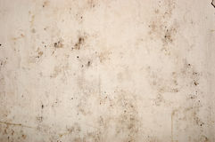 The old peeled wall. With dirt stains Royalty Free Stock Image