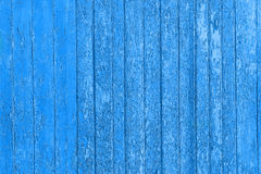 Old peeled wooden planks with cracked color paint, background old panels. Stock Images