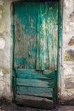 Old peeling green wooden door. Horizontal frame Stock Photos