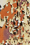 Old peeling paint background. Rusted metal covered with an old cracked paint royalty free stock image