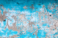 Old peeling paint on old blue concrete wall background Royalty Free Stock Photo