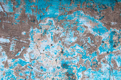 Old peeling paint on old blue concrete wall background Stock Image