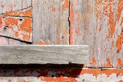 Old Peeling Red Painting on Wooden Door Background. Suitable for Presentation and Web Templates. Close up Old Peeling Red Painting on Wooden Door Background stock photography