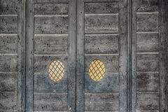 Old peeling wooden door Royalty Free Stock Photos