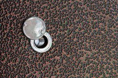 Old peephole on the metal door Royalty Free Stock Photos
