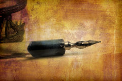 Old pen. Old calligraphy pen on paper with copy space Royalty Free Stock Photo