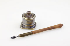 Old pen and antique metallic inkwell Stock Photo