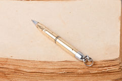 Old book and pen Stock Photo