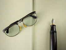 Old Pen with glasses Royalty Free Stock Image