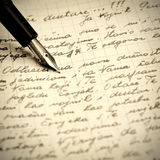 Old pen and letter. Close up photo Stock Image