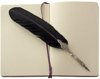 Old pen over notebook Royalty Free Stock Photography