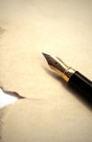 Old pen and paper. Old paper with elegance fountain pen Royalty Free Stock Photos