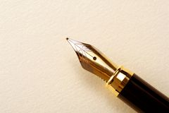 Old pen and paper. Old paper with elegance fountain pen Stock Image