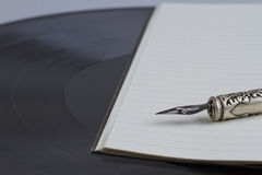 Old pen and vinyl Royalty Free Stock Photo