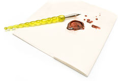 Old pen and wax seal on a letter Royalty Free Stock Photo