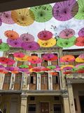 Old Penang. A ceiling of Chinese fans against a heritage building Stock Images