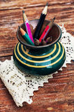 Old pencils in glass coasters Stock Image