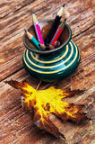 Old pencils in glass coasters Stock Photography