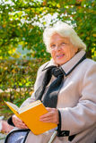 Old pensioner reading a book Royalty Free Stock Photography