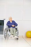 Old pensive woman sitting in wheelchair Stock Images