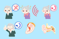 Old people with ear problem. On the blue background Stock Photo