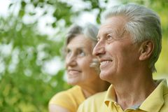 Old people embracing outdoors Stock Images
