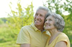 Old people embracing outdoors Stock Photography