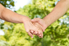 Old people hands holding together Stock Images
