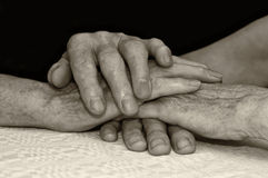 Old people hold each others hands. Stock Photo