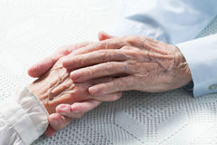 Old people holding hands. Closeup stock photography
