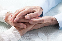 Old people holding hands royalty free stock photography