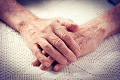 Old people holding hands. Royalty Free Stock Photo