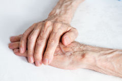 Old people holding hands. Closeup. Stock Images