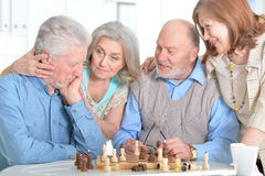Old people play chess. At the table Stock Photo