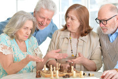 Old people play chess Royalty Free Stock Photo