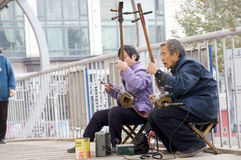 Old people play erhu for charity Royalty Free Stock Image