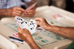 Old people playing cards. A group of elderly people playing card Stock Image