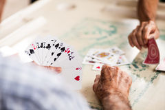 Old people playing cards. A group of elderly people playing card Royalty Free Stock Photography