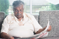 Old people reading newspaper Stock Image