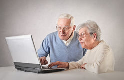 Old people using a laptop royalty free stock photography