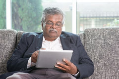 Old people using modern technology Stock Photo