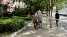 Old people walking slowly in the street