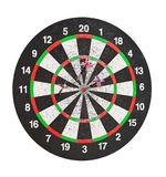Old perforation dartboard with flags on darts. Isolated on white Royalty Free Stock Images