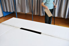Old person in cane voting Stock Image