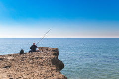 Old person fishing Royalty Free Stock Images