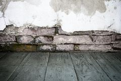 Old perspective wooden floor and cracked brick wall Royalty Free Stock Image