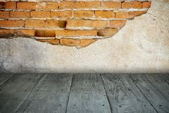 Old perspective wooden floor and cracked brick wall Stock Images