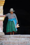 Old Peruvian Woman. An old Peruvian woman standing on church steps wearing traditional clothing Stock Photography